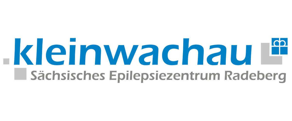 Logo von Kleinwachau - Sächsisches Epilepsiezentrum Radeberg, blau-grau